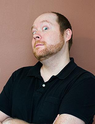 portrait of a man making a goofy face