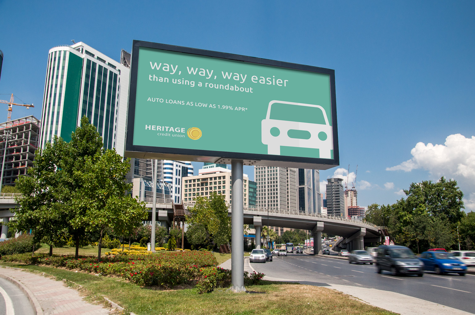 Heritage Credit Union's sign design displayed on a billboard in a city